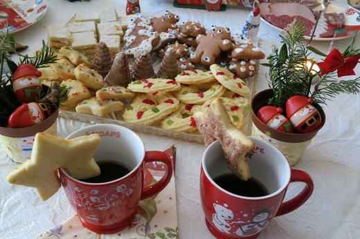A variety of Christmas cookies with two cups of coffee