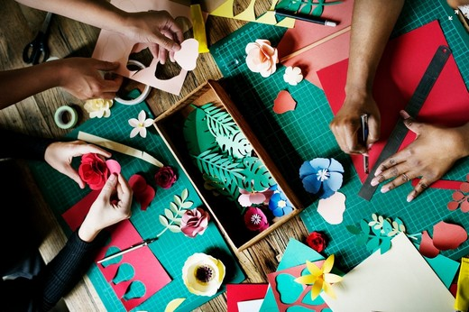 A group of people doing hobby crafts