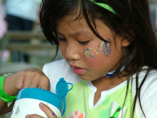 Girl playing with face paints