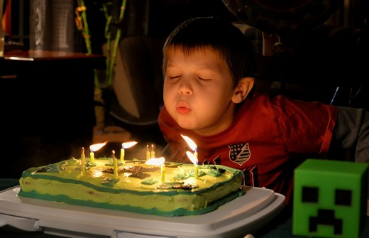 Boy blowing birthday candles