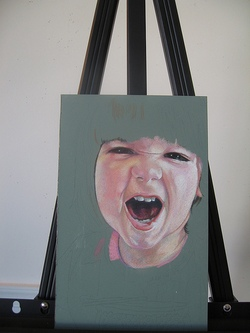 Child's facial expression drawn on a board