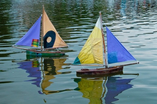 Model boats floating on water