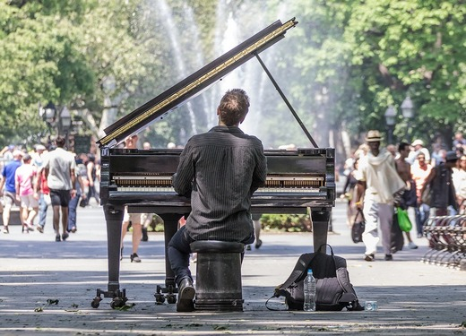 Man playing a piano in public on Manhattan