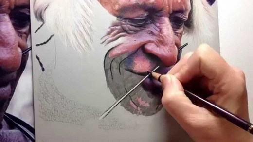 A street artist at work, drawing a man's face