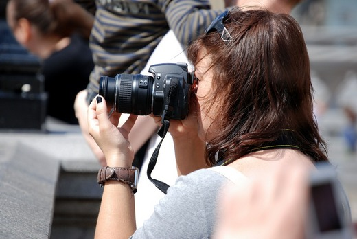 A woman taking a photo with camera